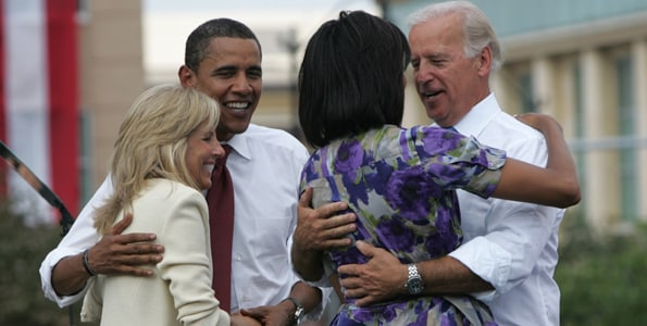 US Democratic presidential candidate Senator Barack Obama (D-IL) embraces Jill Biden, the wife of his vice presidential running mate Senator Joe Biden (D-DE) (R), who greets Michelle Obama, at a campaign event at the Old State Capitol in Springfield, Illinois August 23, 2008.  REUTERS/Kamil Krzaczynski (UNITED STATES) US PRESIDENTIAL ELECTION CAMPAIGN 2008 (USA)